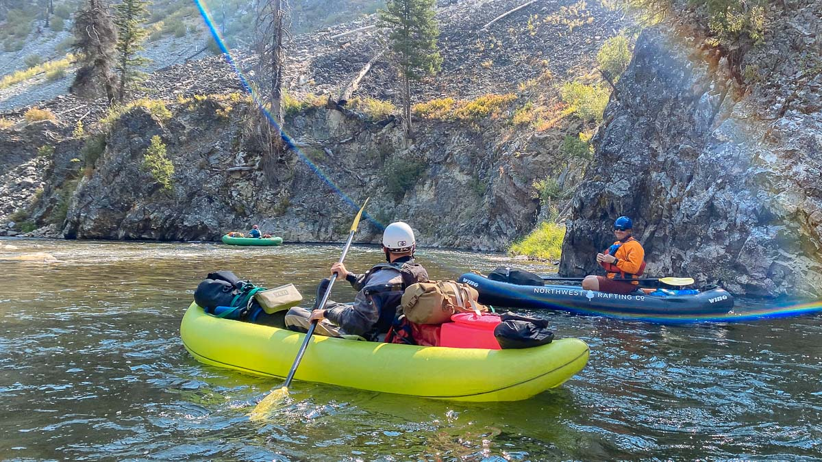 Aaron paddling on the Salmon River with a Selway Fabrication Mini-Bank Toilet in his inflatable kayak